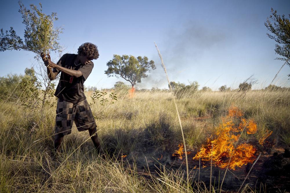 """5 June, 2012 - Yagga Yagga Rd.   """"Firestick Farming"""", controlled burns that revitalize Australia's desert agriculture are regarded as an responsibility of the Wirrimanu men"""