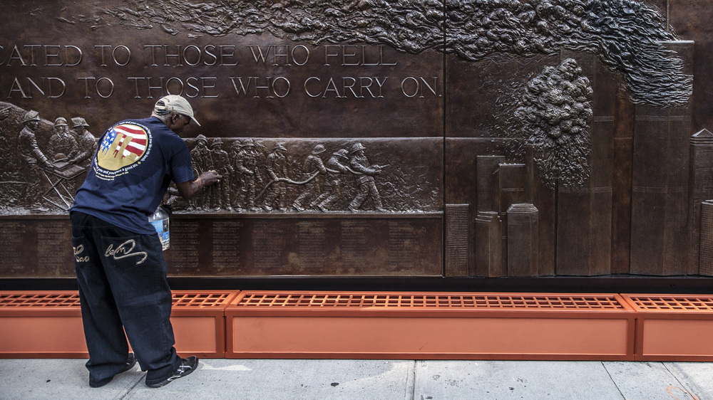 11 September, 2013 - New York, U.S.A.   Memorial at New York Fire Department Company 10 at the foot of World Trade Center One, is cleaned in preparation for 12th anniversary services