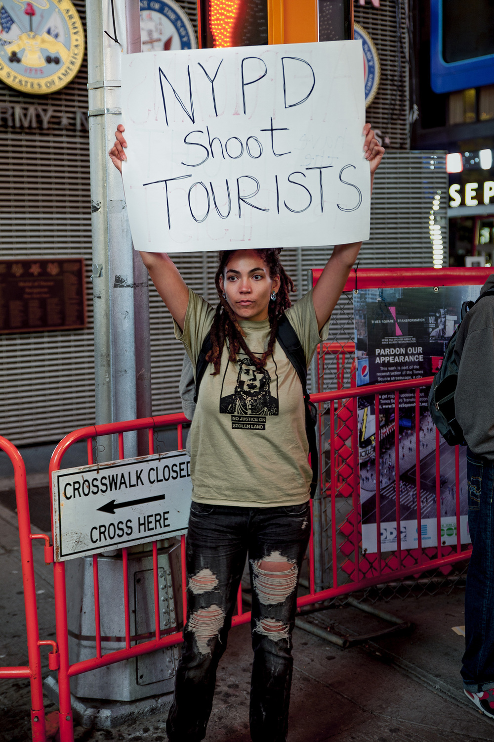 September, 2013 - New York, U.S.A.   Protester in Times Square where earlier police fired upon Glenn Broadnax, 35, of Brooklyn, who was later found to be unarmed. Broadnax was unharmed however two tourist bystanders were wounded