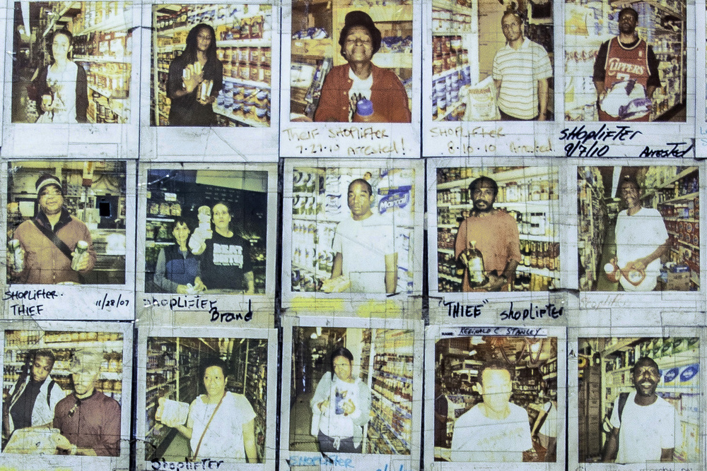 """16 September, 2013 - Brooklyn, New York   A Polaroid gallery of """"Shoplifters"""" and """"Thieves"""" greets customers at the entrance to the Pioneer Supermarket on Parkside Avenue, Prospect Park"""