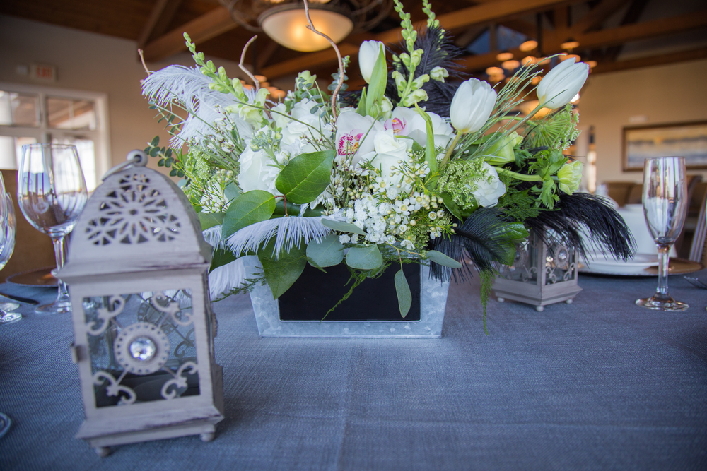 Centerpiece can also used as a table marker. Feathers add some intrigue.