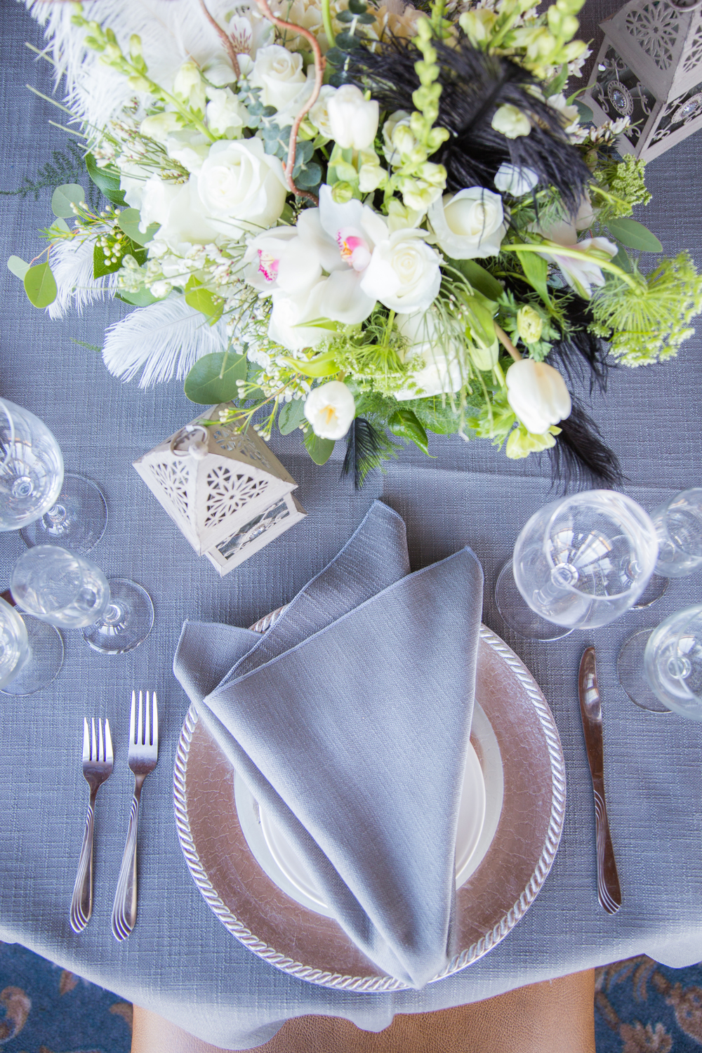 A gray overlay & grey napkins keep with the theme.