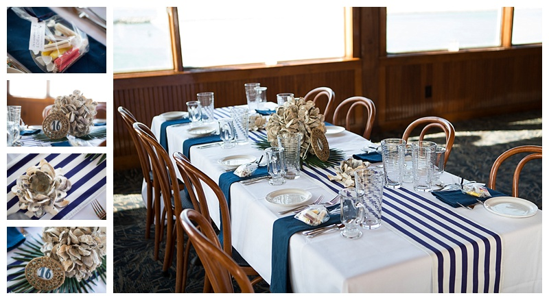 Navy striped table runners & dark napkins accented with oyster shell votives and a Oyster ball on palm fronds. What a simple take on the nautical theme.