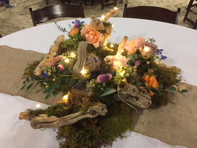 Fresh flowers, driftwood, moss  and burlap. Flowers by Maddie @ Flourish