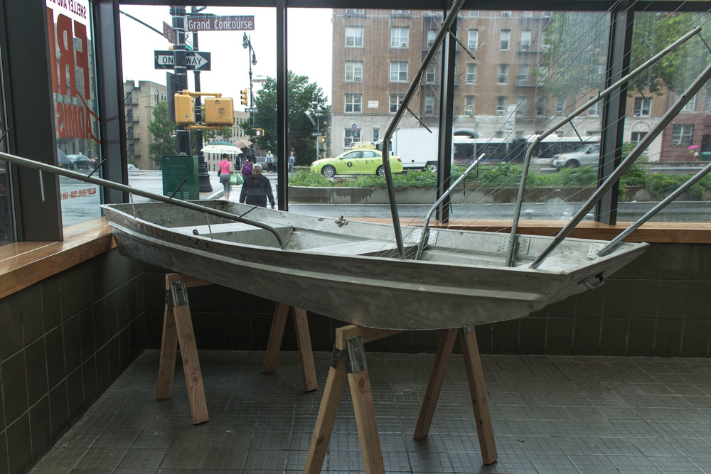 "Prototype #1, ""Reproducible At Any Nearby Home Depot Store"" (2015) is  a boat designed to catch jumping invasive carp using components sourced from a inexpensive components, collectively costing less than $1000."