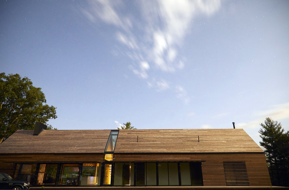 the middle skylight divides the main house into a private bedroom wing, and a more open/public living wing