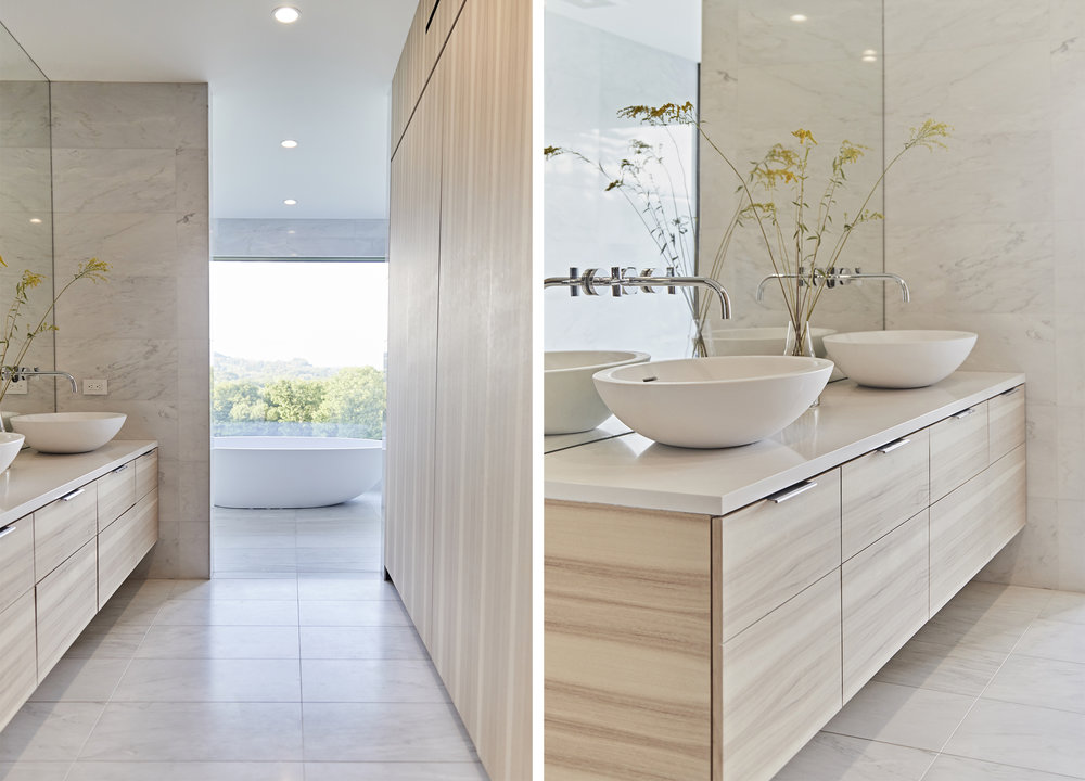 Local materials were selected throughout the house interior, here in the master ensuite pecan/hickory was chosen for the vanity and domestically quarried white marble for floors and walls