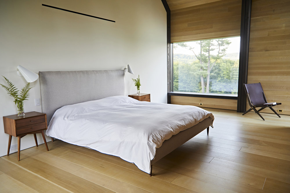Natural White oak was used as flooring, wall linings and ceiling linings throughout the entire ground level of the barn-like residence