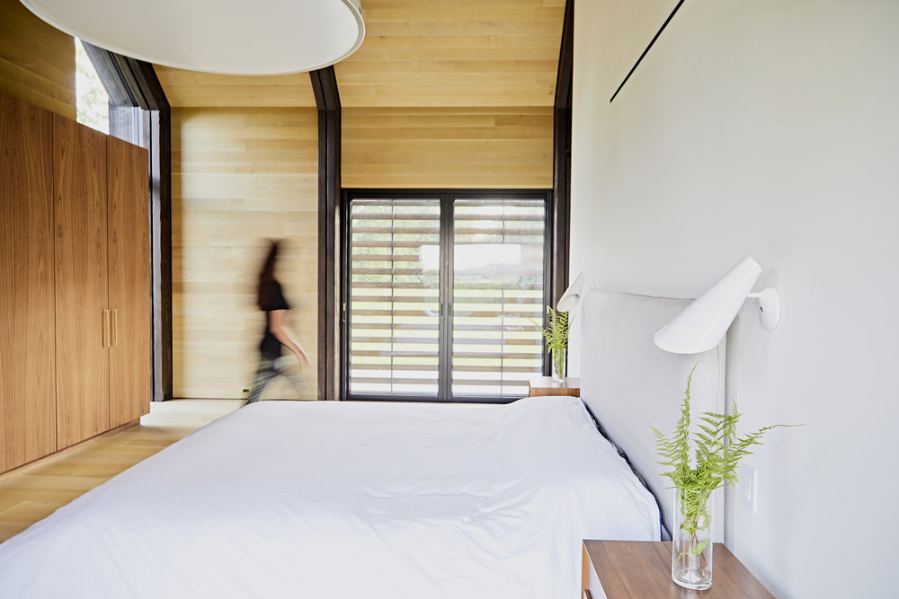 French Doors of the Master Bedroom Suite lead directly out to the garden and decking to the south