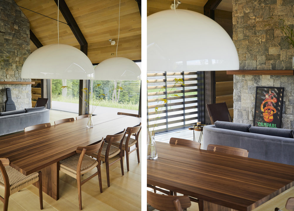Two classic European pendants hang over the walnut dining table.