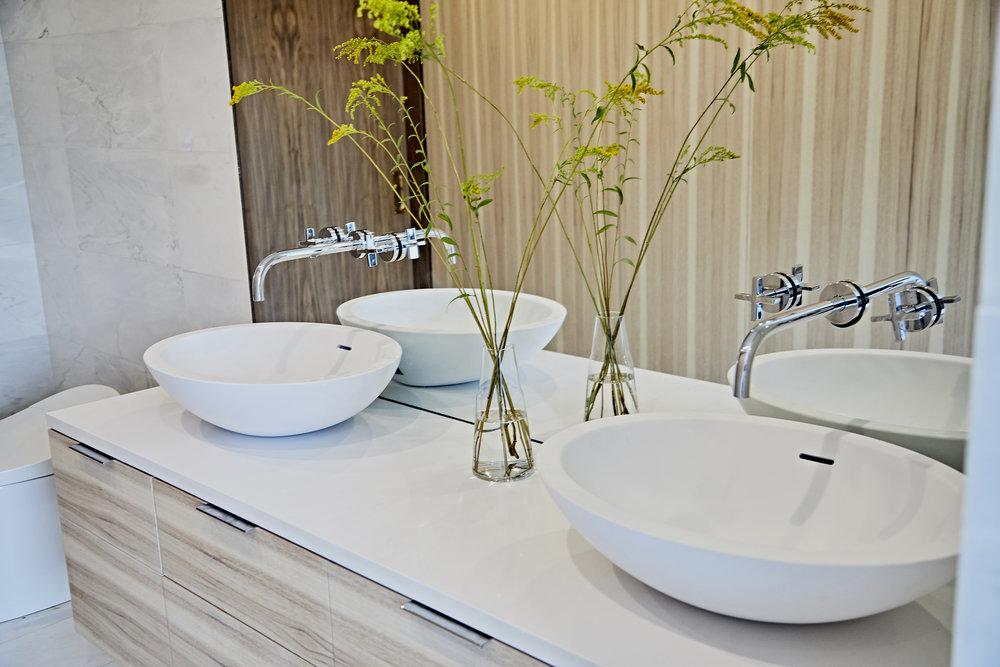 Hickory, Walnut, white marble and white countertops keep the master ensuite simple, clean and uncluttered