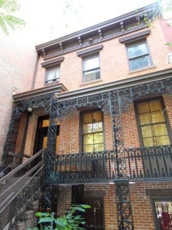 HISTORIC 1852 ROWHOUSE FACADE RESTORATION