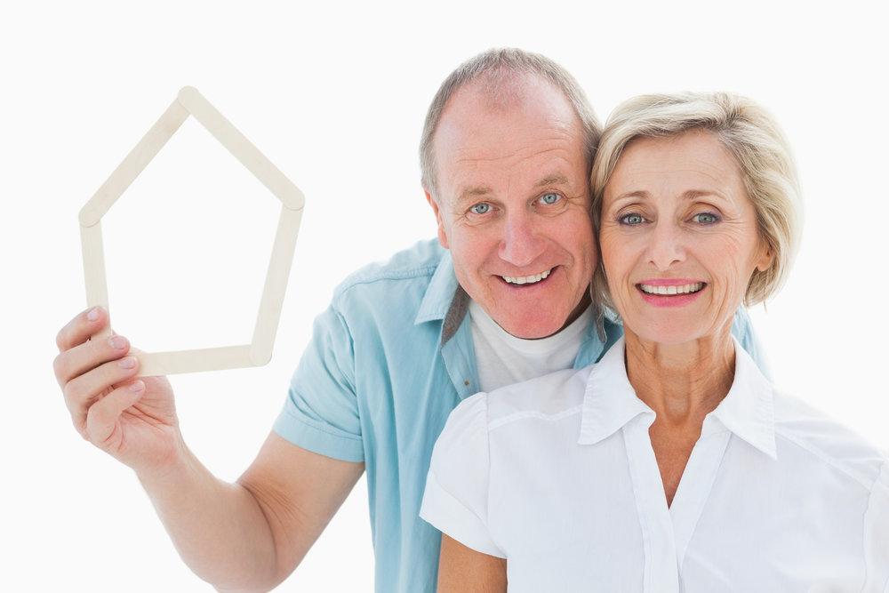 photodune-8673784-happy-older-couple-holding-house-shape-on-white-background-m.jpg