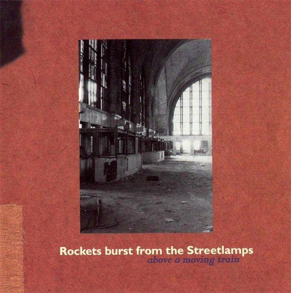 Arch 05 - Rockets Burst from the Steetlamps - Above a Moving Train - CD