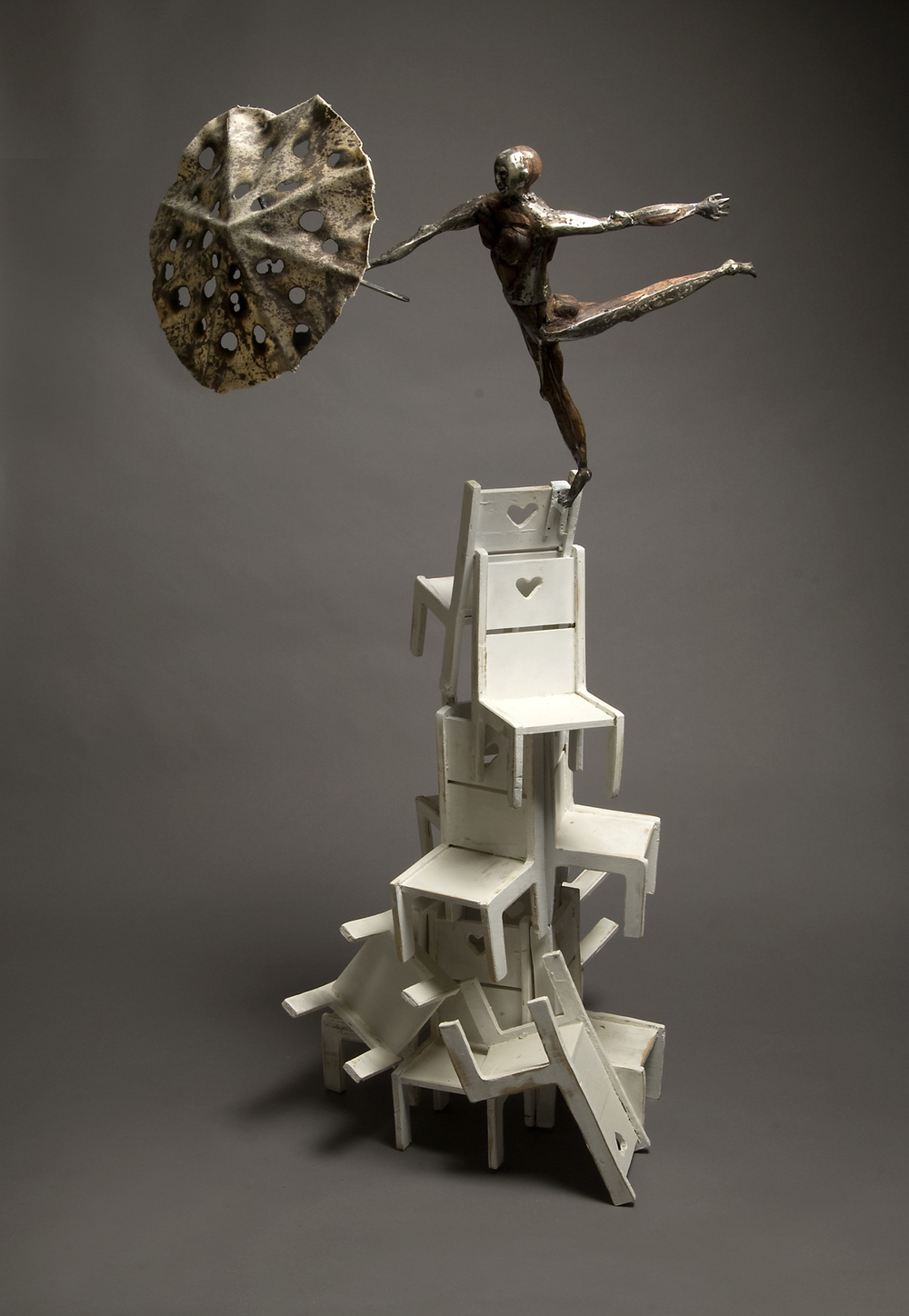 """Tolley Marney's sculpture, Harmony is hand forged steel, oak, pine and cloth. Dimensions: 48"""" tall."""