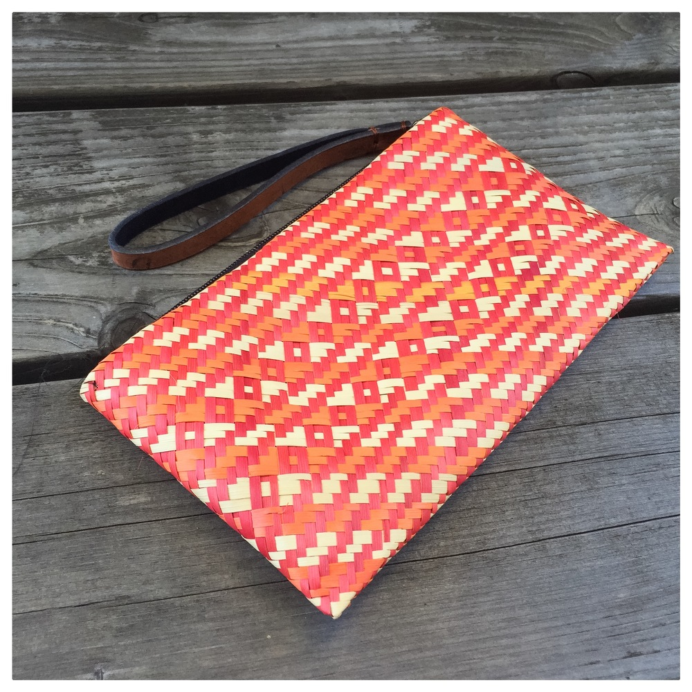"The Ruby Wristlet is handmade from grass by women in Uganda. It is large enough to hold your phone, keys, and more. 8"" x 5"". Special thanks to Julie at  Cobalt Collective  for supporting Reeds of Hope! Check out their shop for more beautiful gifts that make a difference!"