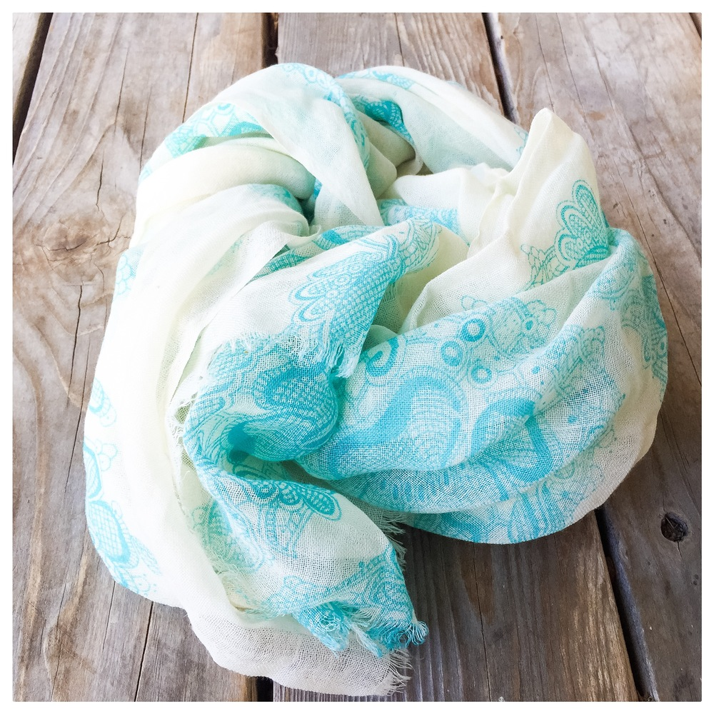 Donated by a generous friend, this aqua and cream colored Bindya NY scarf is the perfect accessory. Lightweight and sophisticated, it is a blend of silk and wool. Inspired by international travel, we hope you love this scarf as much as we do.