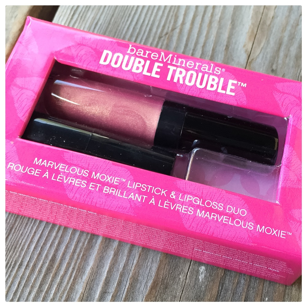 Nothing sentimental about this, we just love Bare Minerals and their natural approach to beauty. The set includes both a lipstick and a lipgloss in coordinating shades- a soft neutral pink.