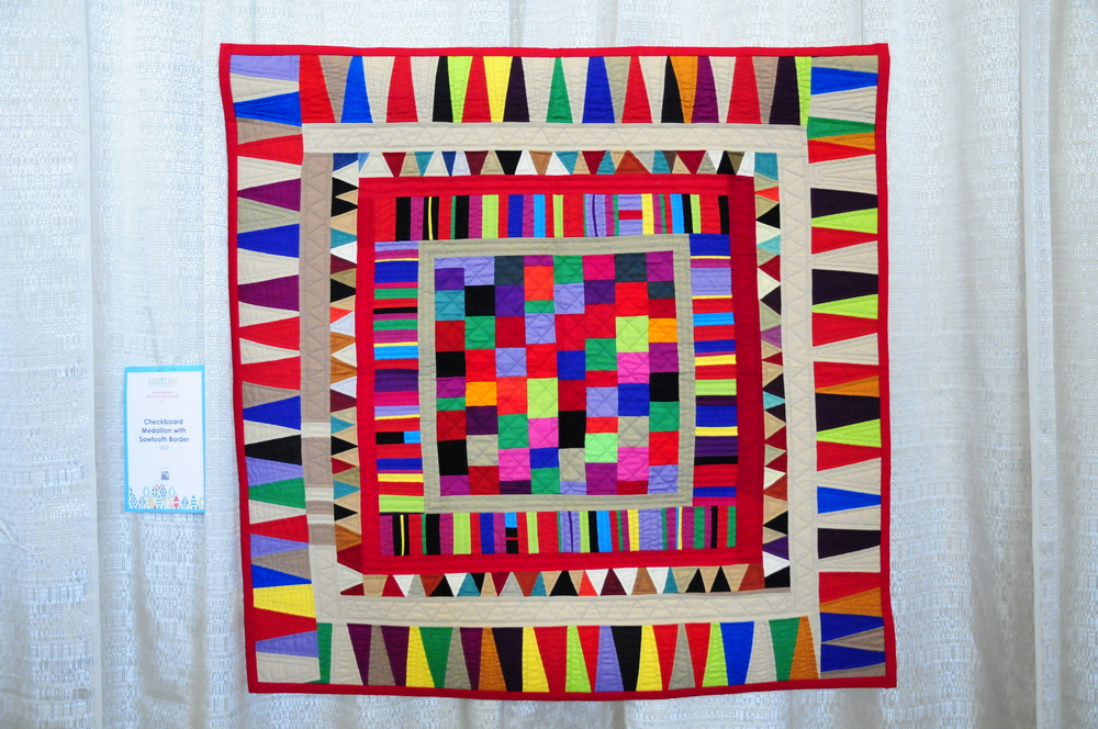 Checkerboard Medallion with Sawtooth Border by Gwen Marston