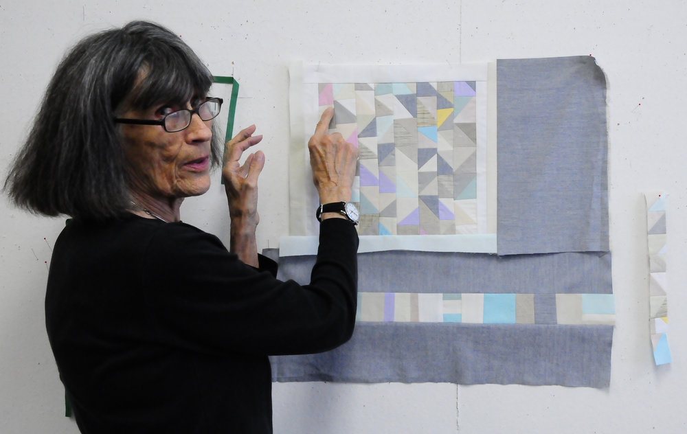 2015 Minimal Quiltmaking workshop, Gwen pointing out my lost triangle points which delighted her!