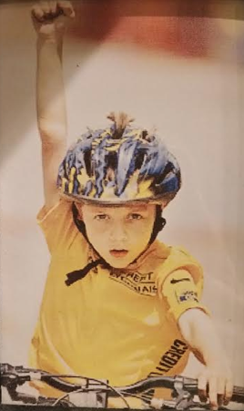 A very young Tyler Reynolds, posting up at a kids race in the Quad Cities