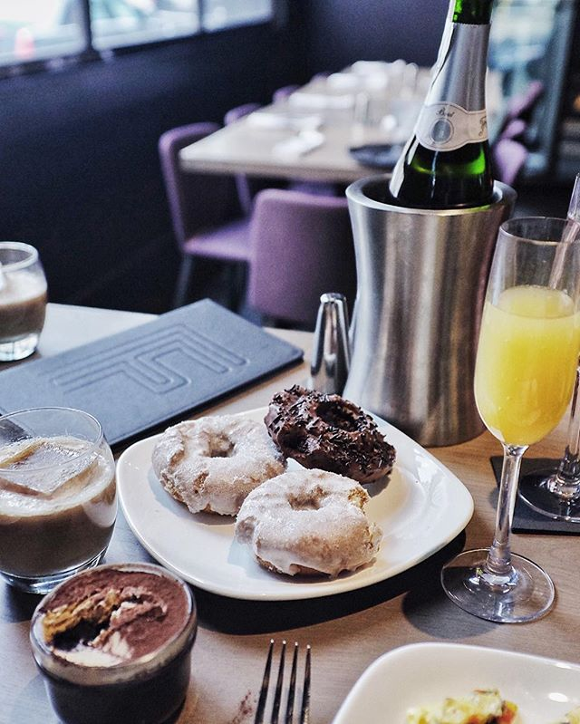 If you're in #Chicago and looking for #brunch, @fremontchicago has a tower of @doughnutvault donuts, coffee cocktails, and every. amazing. food in between at their brunch buffet!