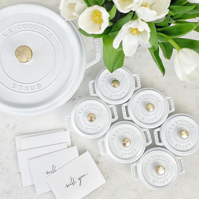 "Friday night I asked four of my oldest friends and my sister if they'd help me ""cook up a good wedding"" and be my bridesmaids by gifting them each a mini @staub_usa + @goop cocotte! White + brass = 😍 #bridesmaidgifts #meettheschmiedskis"