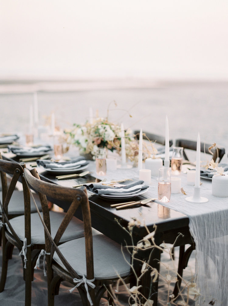 SOURCES:   Candle Holders   (all three sizes)   Linen Napkins,    S  ingle Stem Vases    (matt white sm & md)   Ceramic Plates ,     Malfatti Prosecco Glass  ,  Froufrou Chic Crinkle Runner    CB2 Flatware ,  Porcelain Votives .              IMAGE BY TYLER RYE
