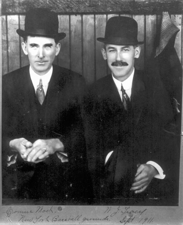 Manager of the Philadelphia Athletics, Connie Mack, and Hartford business owner and baseball proprietor, William J. Tracy at the New York Baseball Grounds, 1911.