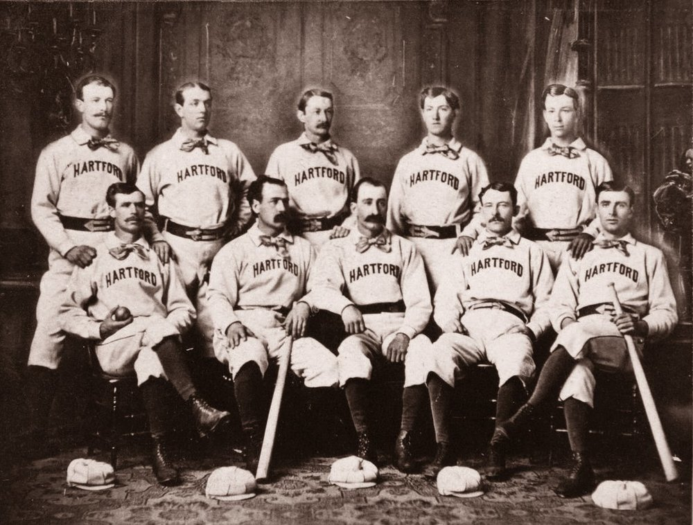 1875 Hartford Dark Blues   L to R, Standing: Jack Remsen, Tom York, Candy Cummings, Tommy Bond and Bill Harbridge. Seated: Doug Allison, Everett Mills, Bob Ferguson, Tom Carey and Jack Burdock.