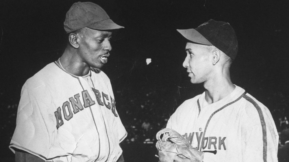 Johnny Taylor (right) after his no-hitter on September 19, 1937 at the Polo Grounds in New York for the Negro National League All Stars against Satchel Paige (right) and the Trujillo All Stars.