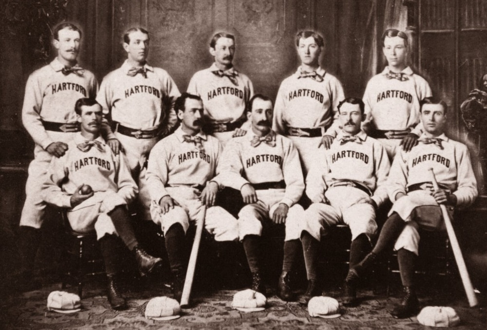 1875Hartford Dark Blues Contend for a Title - Led by their player-manager, Bob Ferguson (sitting, center) and the club has their best season, finishing second place in the National Association trailing only the Boston Red Stockings.