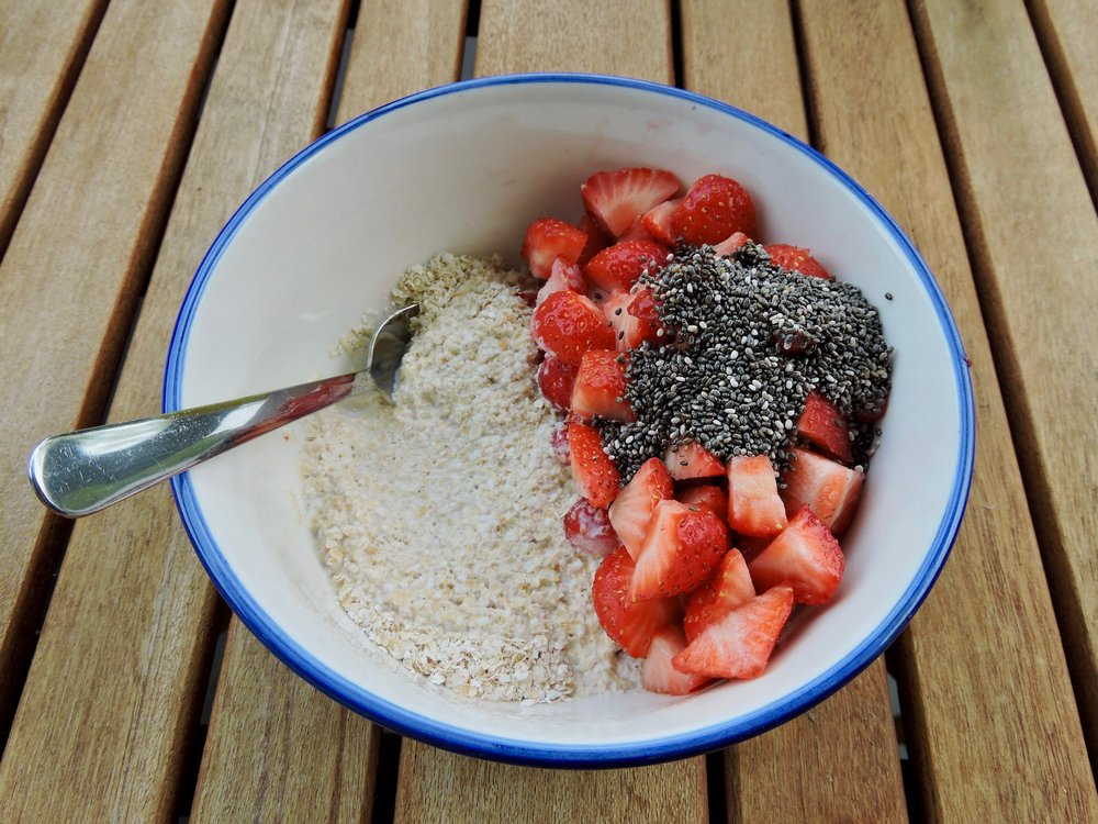 Flaked oats with almond milk, strawberries, and chia seed.