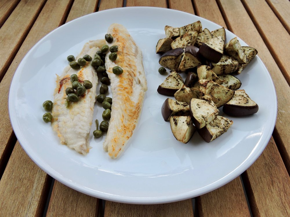 Baked white fish with capers and steamed eggplant.