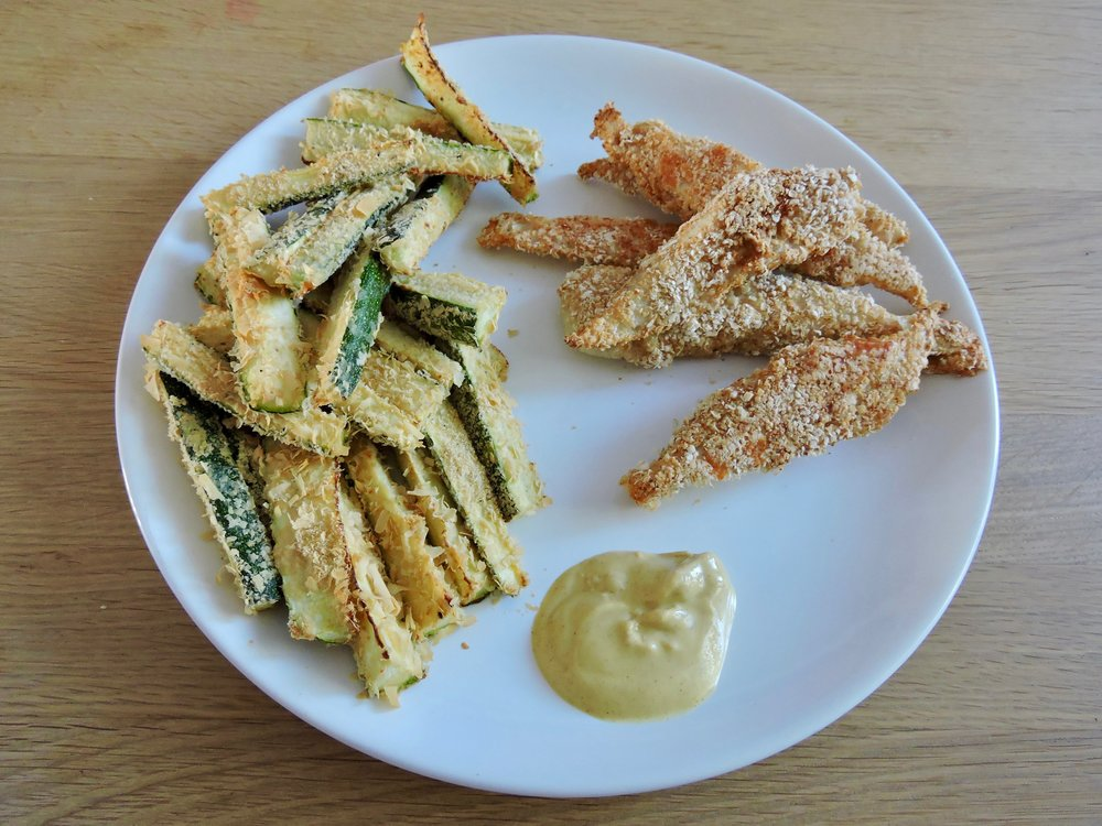 Oat-crusted chicken tenders with zucchini fries.
