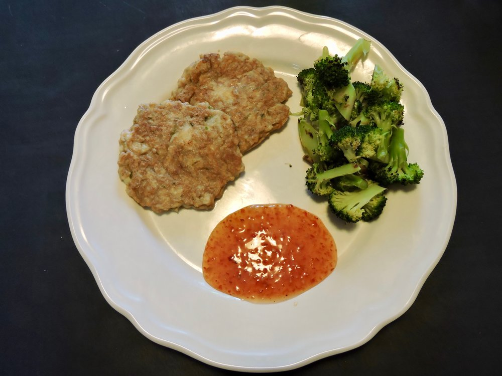 Thai fish cakes with steamed broccoli.
