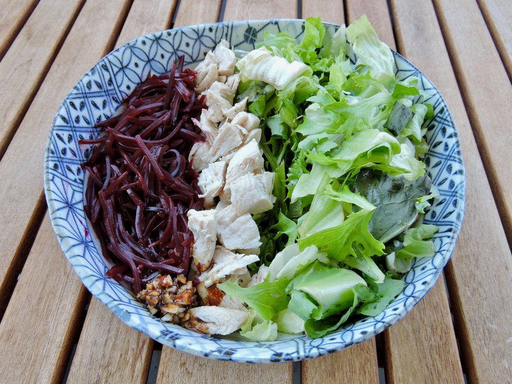 Salad with greens, chicken breast, and beets