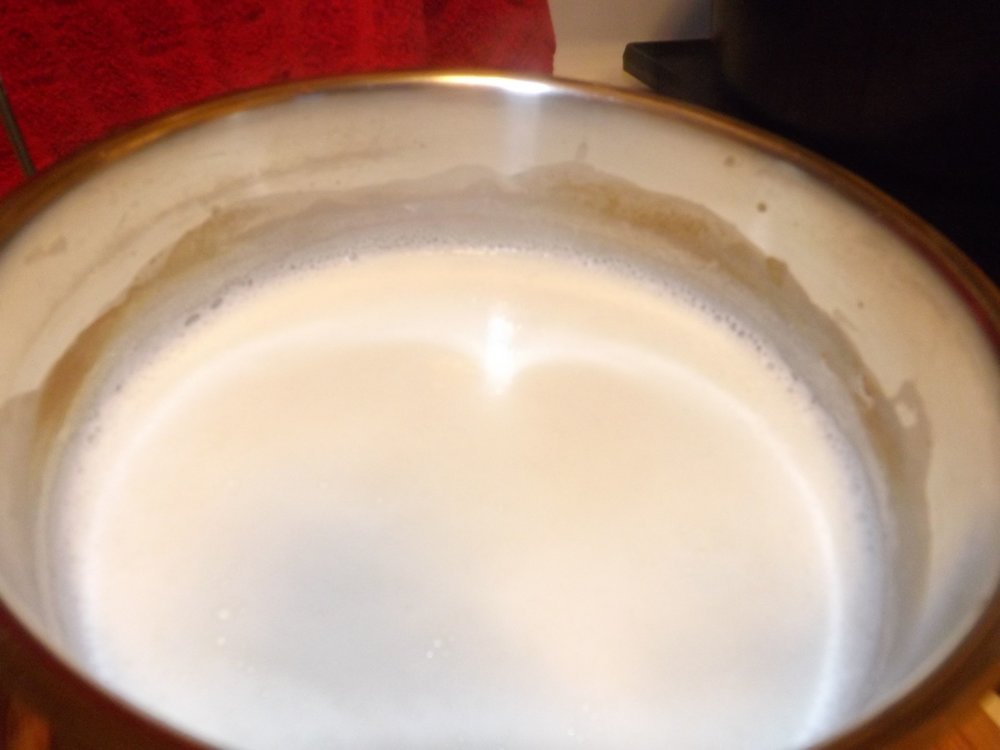 Once the milk reaches 180 degrees, it's frothy and little bubbles start to from around the edge of the pan.  Stir occaisionally so as not to scorch the bottom of your pan.  Yuck.