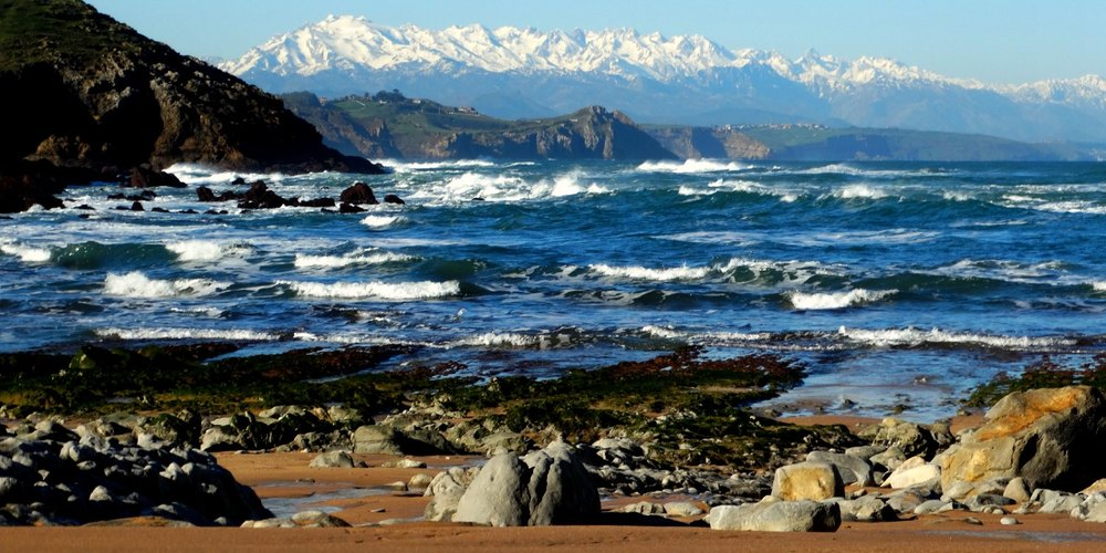 Picos de Europa mountains towering above the Cantabrian Sea