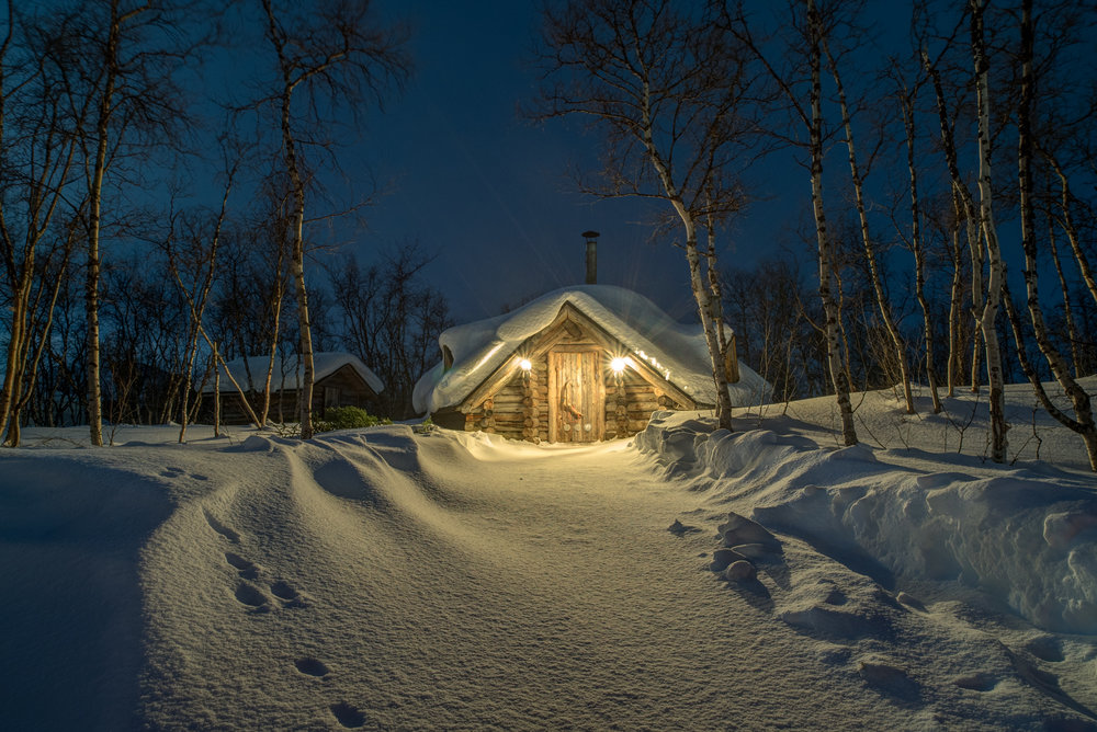 This was taken of a kota, or warm hut, in the Lapland region of Finland. I passed by this perfect scene a few times, but when I saw the animal's footprint in the fresh snow I ran and grabbed the gear. I shot at a low angle to emphasize the footprint and make the hut seem a little larger than life.