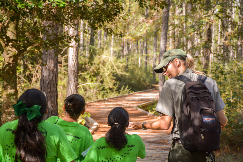 In Texas' Big Thicket National Preserve, Ranger Alex Halbrook leads and teaches school children who are part of the NPT's Buddy Bison program. The educational outreach program provides parks, wilderness and STEM opportunities to K8 kids in more than 60 schools across the U.S. Photo courtesy of the National Park Trust.