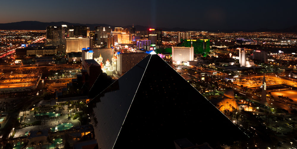 High-contrast scene mixing Las Vegas city lights and deep shadows.