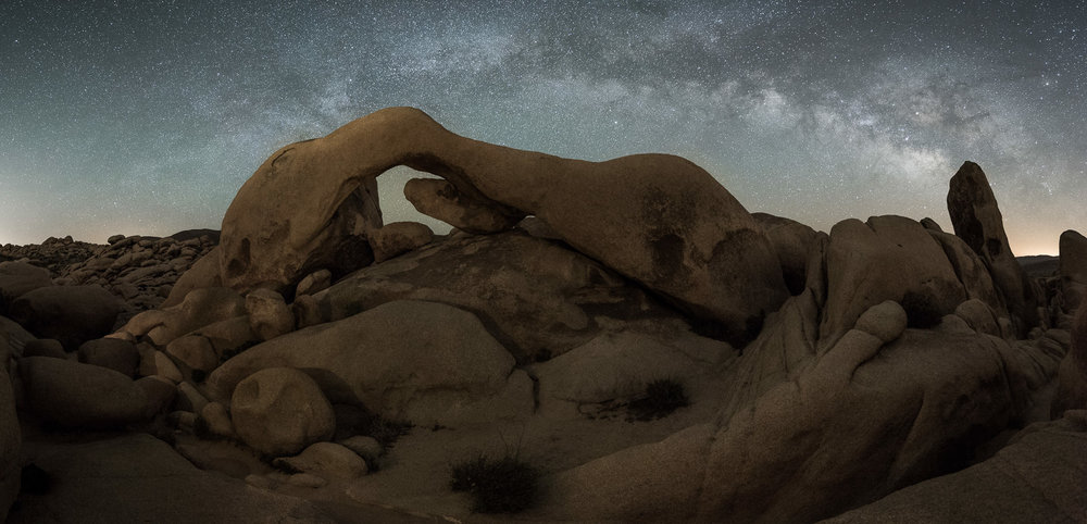 A great example of low-level lighting: In Joshua Tree National Park, Arch Rock, at 30 feet high, was light-painted by just three battery-operated votive candles. Illumination barely visible to the naked eye even from close-up. Six stitched frames shot with a  Nikon D750  and a  Tamron 15-30mm f/2.8  lens at 15mm Photo © 2017 Lance Keimig.