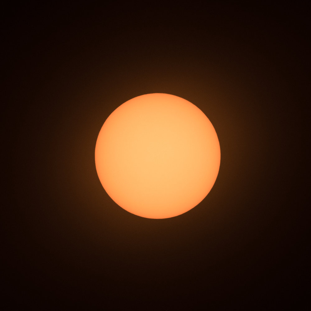 Sun shot with Daystar filter at 10,000 K white balance. 1/500, f/5.6, ISO 800.