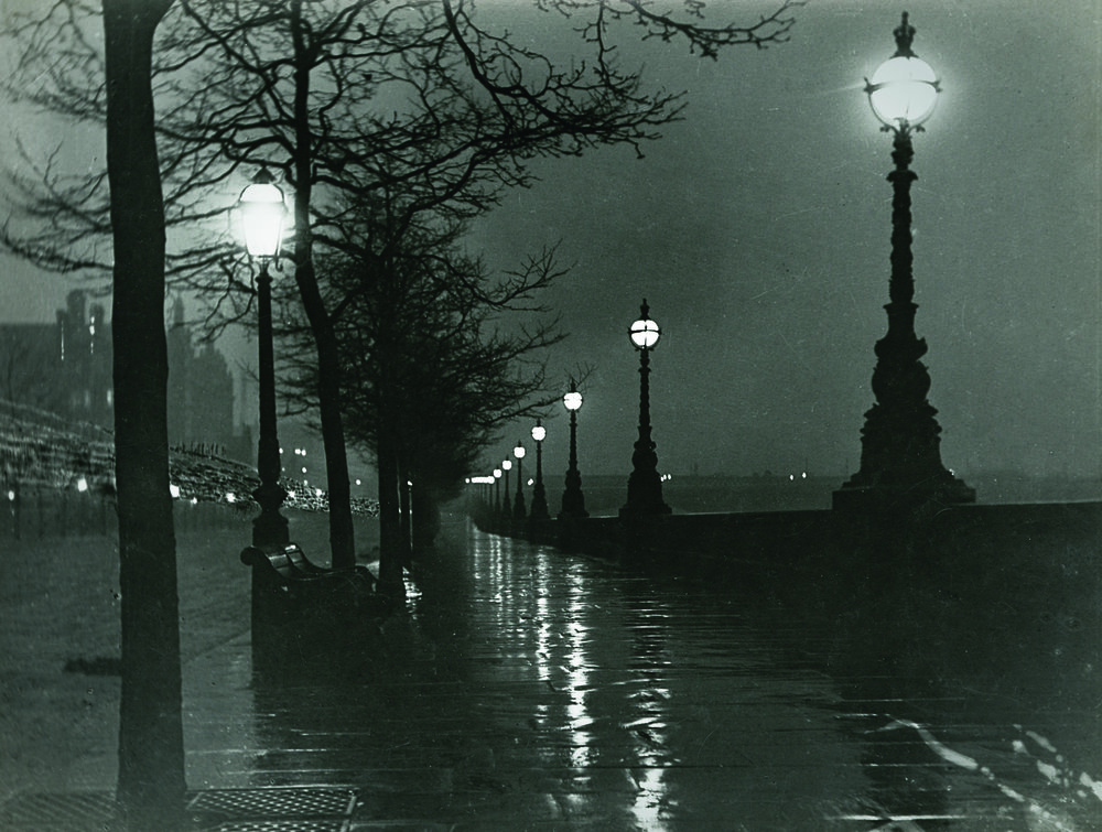 "Paul Martin, ""A wet night on the embankment,"" 1895. Martin covered his camera lens during the exposure to shield it from a curious policeman's lantern."