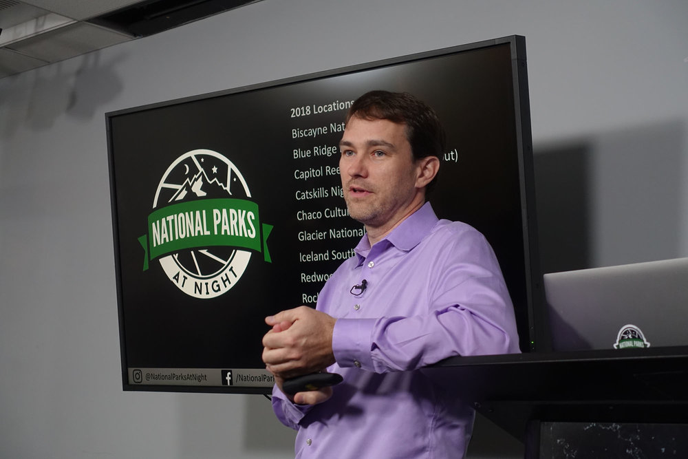 Me talking about starry skies while surrounded by National Parks at Night logos. Photo courtesy of  Klaus-Peter Statz .