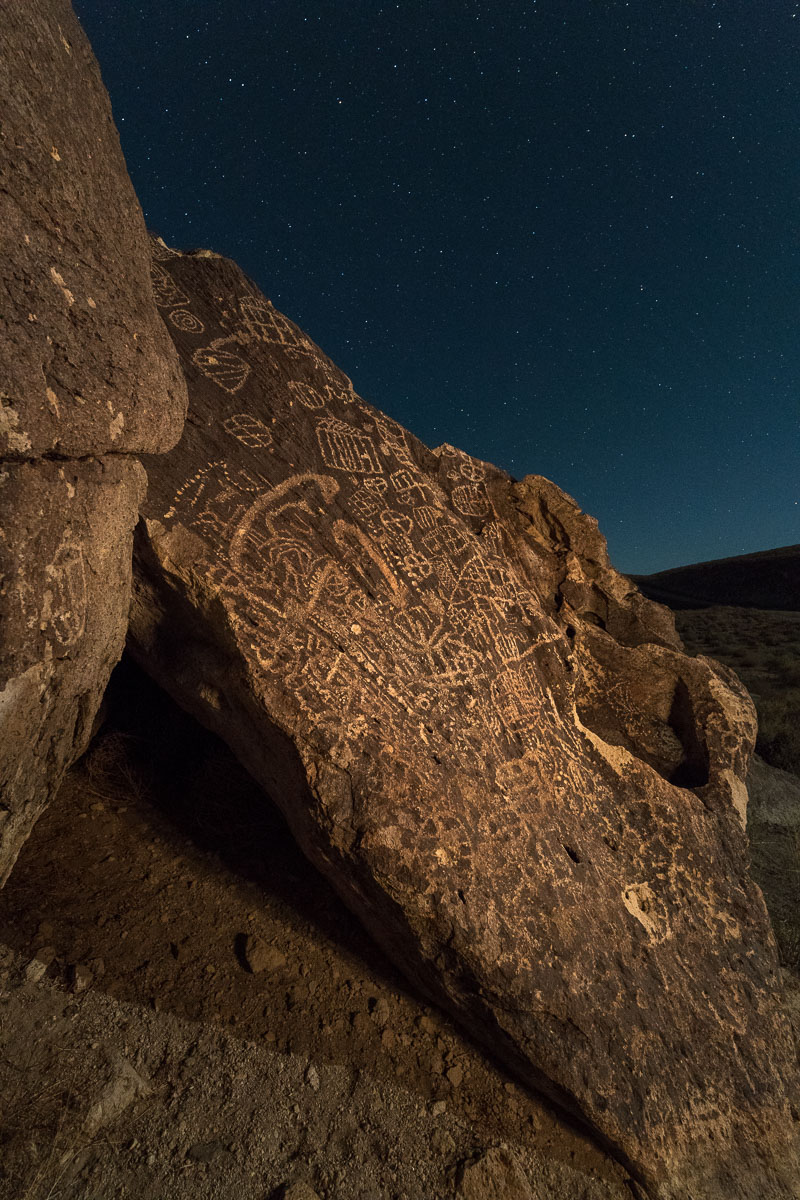Petroglyphs, Volcanic Tablelands, Bishop, California. Illuminated from the right with a warm-gelled Coast HP5R flashlight. Nikon D850. 15 seconds, f/9, ISO 6400.