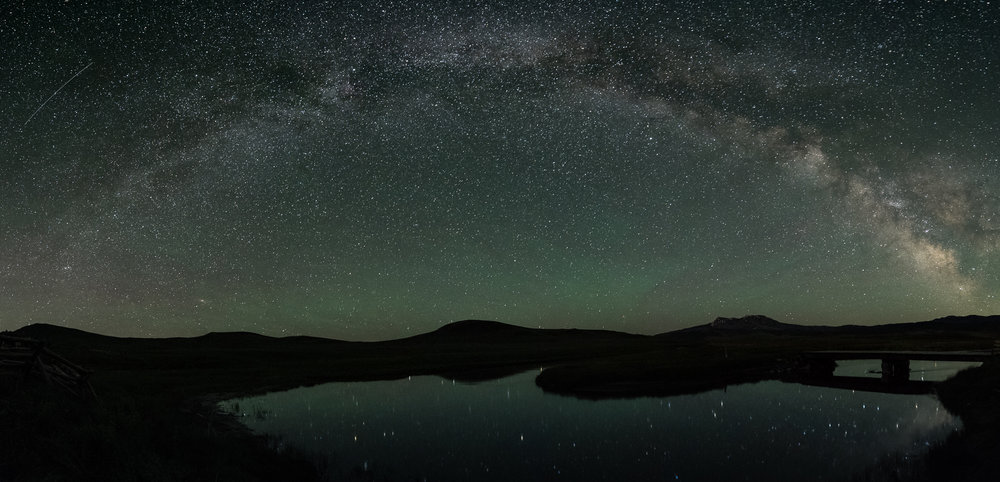 Milky Way pano over Montana. Seven stitched images shot at 30 seconds, f/4, ISO 6400.  Nikon D750  with  Nikkor 14-24mm f/2.8  lens at 14mm. Photo © Gabriel Biderman.