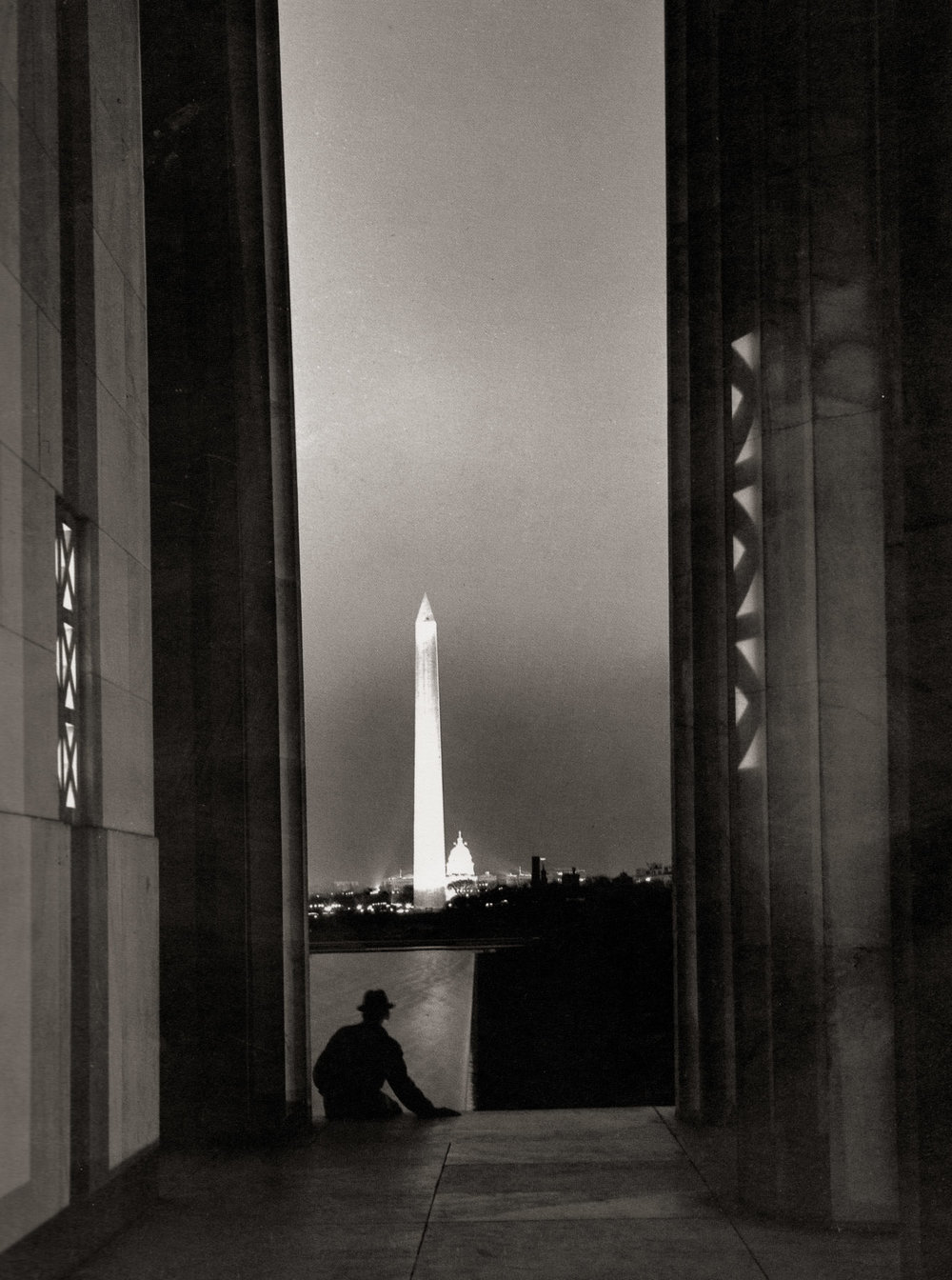 """The Mall."" The classic view of Washington: the Capitol peeking out from behind the Washington Monument as viewed from between the columns of the Lincoln Memorial. The shadowy figure in the foreground is Wentzel's friend Eric Menke, the man who gave him his copy of Barassai's book."