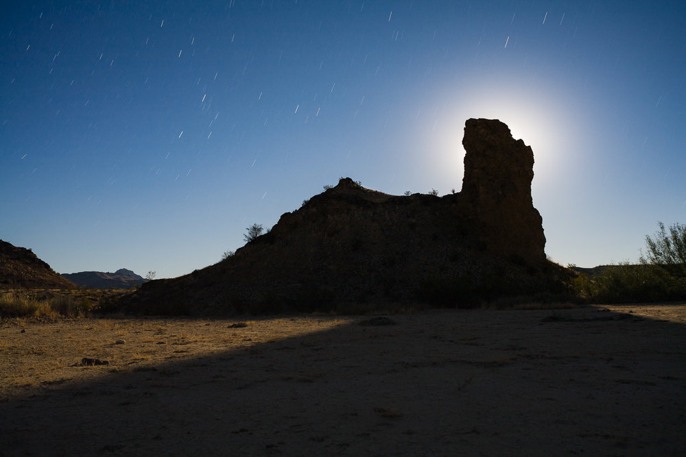 Study Butte, Texas, 2007. The moon rises behind a rock formation in the Texas desert. I achieved careful exposure and backlight by placing the rising moon behind the rock, which made this a much more interesting photograph than it would have been if it were front-lit and fully exposed.  Canon 5D , lens unrecorded. 268 seconds, aperture unrecorded, ISO 100.